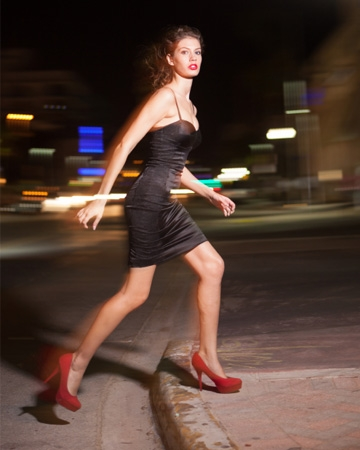 woman-walking-streets-after-dark-vert